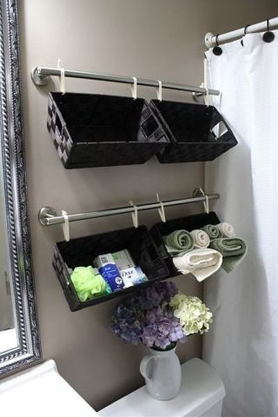 Small bathroom DIY organization idea:  2 towels bars, 4 baskets and you suddenly have more storage room in all small bathrooms.