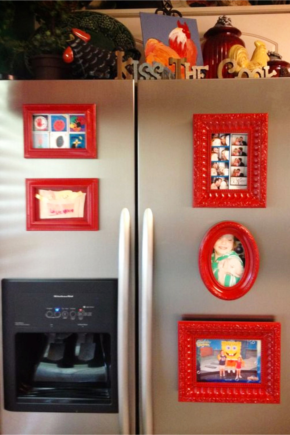 Decorate your refrigerator with magnetic picture frames - sure declutters all the STUFF on your fridge