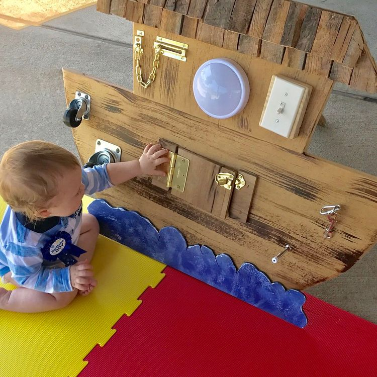 LOVE this DIY sensory board - look how cute it turned out! It looks like Noah's Ark! What a great idea!